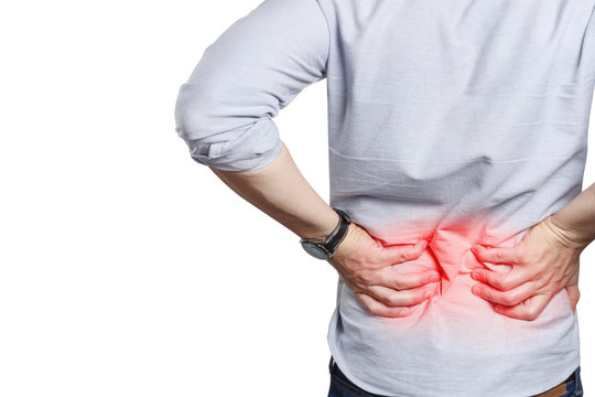 Man suffering from a lower back pain, isolated on white background