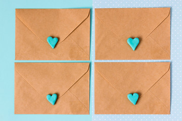 Blue gift box with jewelery and many small heart are all around. An envelope with love. The background is blue. The best gift for any holiday. Mock up. Free space for text. Succulent.