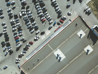aerial top view of many cars on the messy parking near the shopping center