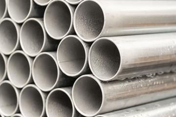 Close - up stack of metal pipe