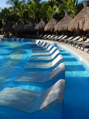 Pool amenities at a tropical resort in Cancun, Mexico