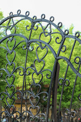 Fragment of forged fence with tracery ornaments