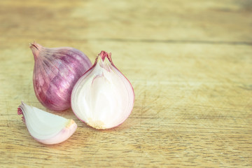 red onion sliced on wooden cutting board