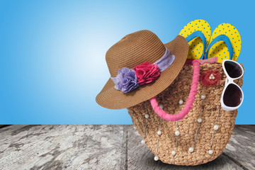 Beach accessories on wooden table with blue wall background