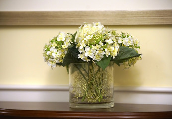 close up on artificial flower in vase on the table