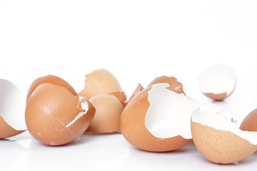 egg shell broken crack pile food on white background