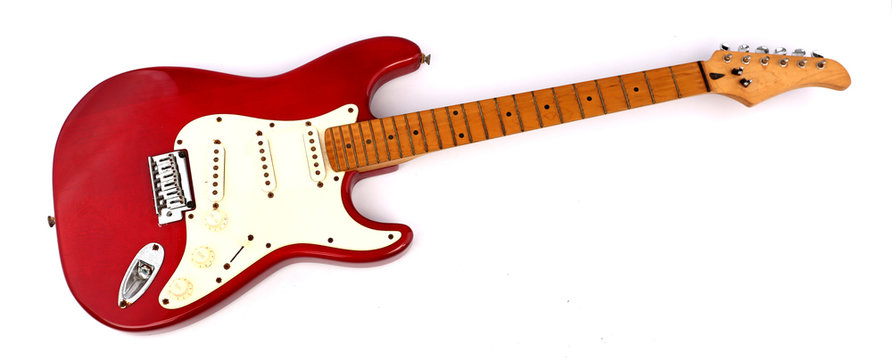 Red electric guitar with white backdrop.