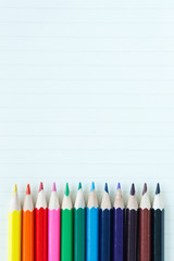 Fototapete - colored pencils drawing multicolored on note book paper background