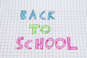 Colored back to school handwritten on a paper
