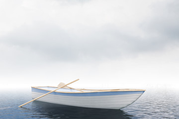 Loney white boat in an open sea, cloudy day