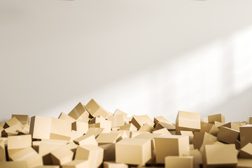 Pile of closed cardboard boxes in white room