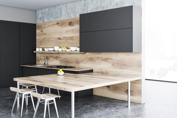 Wooden and black kitchen corner, table