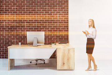 Woman in white and brick manager office interior