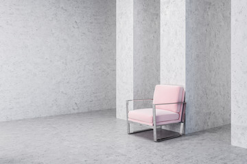 Pink armchair in empty concrete living room corner