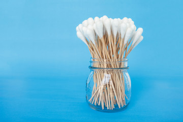 cotton bud in jar swab clean healthcare on blue background