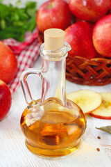 Apple vinegar. Bottle of apple vinegar on wooden background