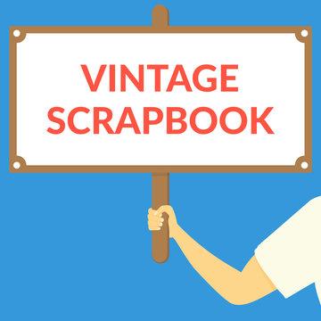 VINTAGE SCRAPBOOK. Hand holding wooden sign