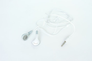 earbuds or earphones on white background