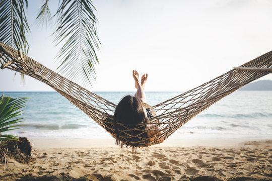 Happy woman relaxing in hammock