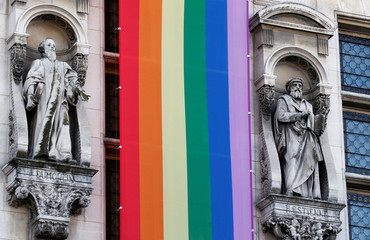 A long rainbow flag is displayed on the facade of Hotel de ville city Hall during the inauguration of the Gay Games village in Paris