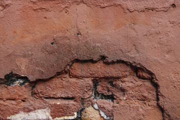 Red broken old brick wall