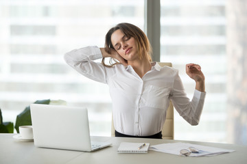 Exercise for neck muscles in office. Female business worker massage neck, stretching in chair, practicing workplace, tired businesswoman relieve pain suffering from sedentary work, taking work break