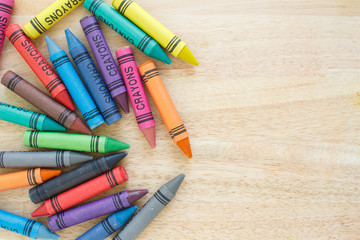 Wall Mural - crayons drawing border multicolored on wooden background