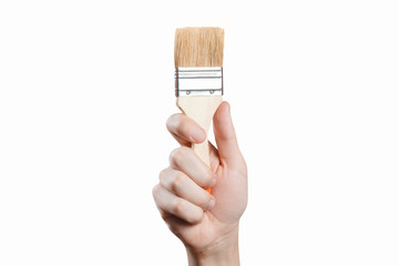 Hand holding a thick brush, isolated on white background