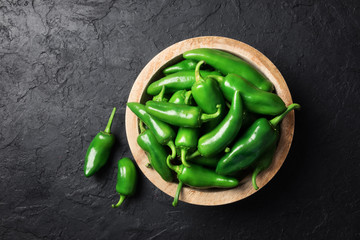Canvas Prints Hot chili peppers Green jalapeno hot pepper in wooden plate closeup. Food photography