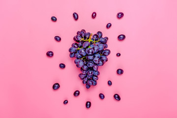 Natural organic black juicy grapes on a trend pink background  Top View Flat Lay. Rustic Style. Country Village Agriculture concepts