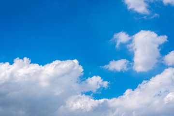 Cloudscape with blue sky and white clouds