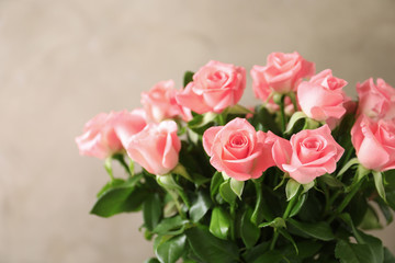 Bouquet of beautiful roses on blurred background