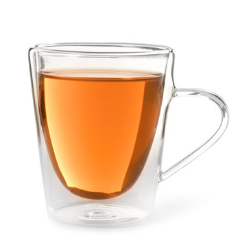 Glass cup of black tea on white background