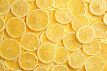 Slices of fresh juicy lemons as background, top view Wall mural