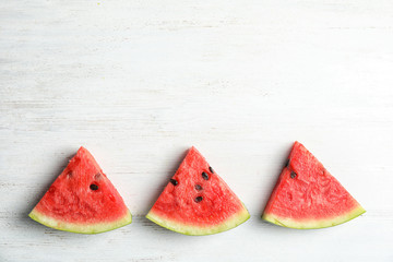 Flat lay composition with watermelon slices on white wooden background