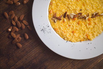 Pumpkin risotto on the plate - a traditional Italian recipe