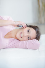 woman lying with cellphone