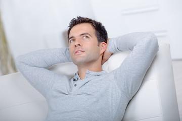 man on sofa thinking