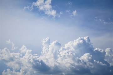 Amazing cumulus clouds with sunlight on the background of clear blue sky, Summer in GA USA.