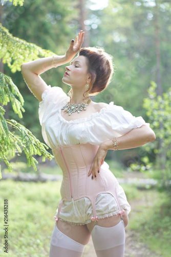e0a676779d beautiful young chubby girl posing in medieval retro corset and white  vintage lingerie in the forest