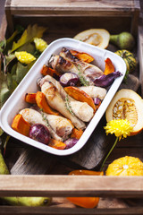 pumpkin baked with chicken. autumn vegetables. tray with food
