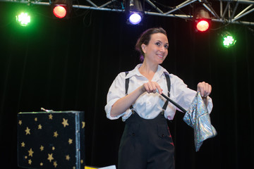 cheerful girl in a circus costume performs at the circus