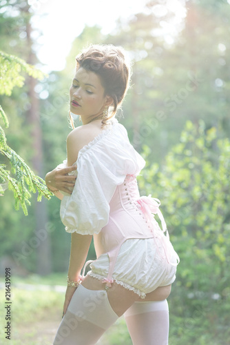 83a2f301d09 beautiful young chubby girl posing in medieval retro corset and white  vintage lingerie in the forest