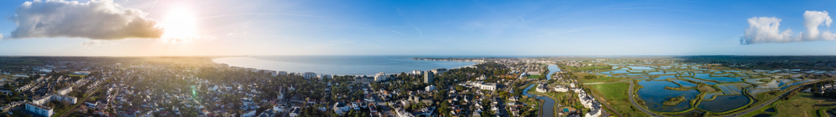 Drone panorama of La Baule Escoublac with seaside, beach and salt marshes.