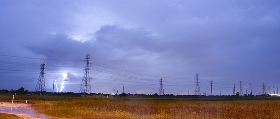 A Texas thunderstorm generate electrical discharge near power lines
