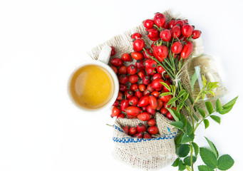 dog rose hips and herbal Tea on white background