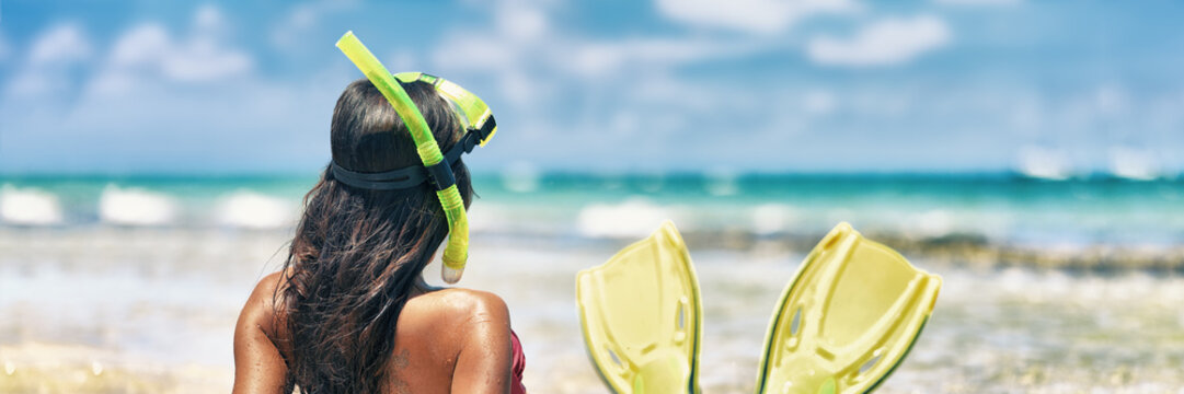 Snorkel girl with scuba mask and snorkeling fins relaxing on Caribbean beach travel summer vacation panoramic banner. Ocean watersport tropical fun.