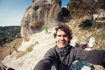 Selfi on the background of rock climbers.