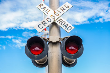 Railroad crossing sign with light signal