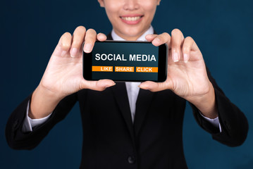 Wall Mural - Social media concept, Happy businesswoman Show text Social media on Smart Phone